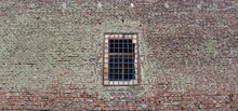 Prison Cell Wall With A Window With Bars