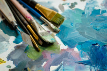Artist Paint Brushes On The Wooden Palette