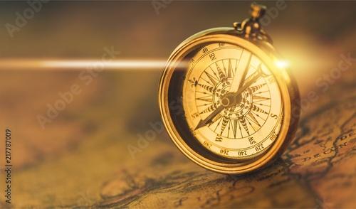 Fototapety, obrazy: Brass antique compass on background