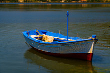 A Small Fishing Boat, Floating...