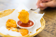 Crispy Fried Chicken Nugget With Tomato Sauce For Dipping On A Fork, Closed Up