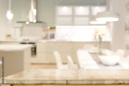 Fototapeta Wooden countertops table with modern kitchen room background. obraz