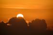 Orange light, sun and big clouds