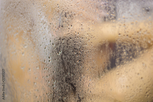 Fotografie, Tablou  Beautiful woman in the shower behind glass with drops