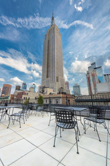 Rooftop cafe overlooking the Empire state building, Manhattan, New York City.