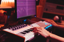 Musician Hands Playing Midi Keyboard Synthesizer For Recording Music On Computer In Digital Sound Studio