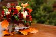 Leinwandbild Motiv autumn flower composition with roses, chrysanthemum and maple leaves