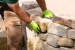 canvas print picture - Handwerker beim Bau einer Trockenmauer aus Sandstein