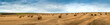 canvas print picture - view of hay bales on the field after harvest