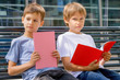 Boys doing homework outdoors. Back to school concept.