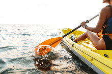 Young Woman Kayaking On Lake Sea In Boat.