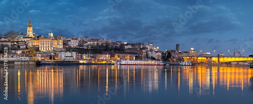 Old Belgrade panorama by night with Cathedral and Branko's bridge on Sava river and city lights water reflections