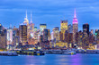 West New York City midtown Manhattan skyline panorama view from Boulevard East Old Glory Park over Hudson River at dusk.