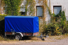 Old Blue Trailer Parked Next T...