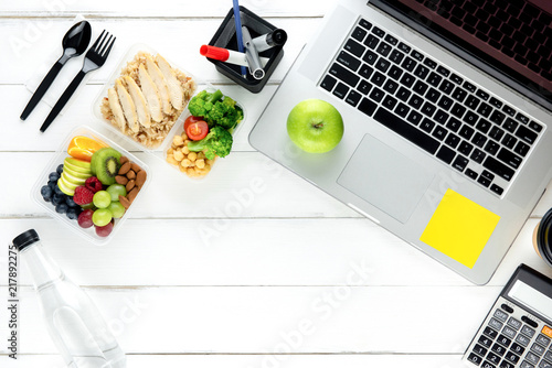 Fototapeta Clean healthy low fat food with laptop computer on working table