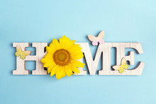 Decorative Word Home With Butterflies And Sunflower On Blue Background.