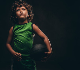 Little basketball player in...