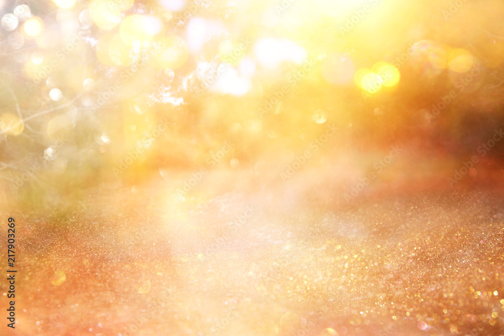 Fototapety, obrazy: blurred abstract photo of light burst among trees and glitter golden bokeh lights.