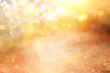 Leinwandbild Motiv blurred abstract photo of light burst among trees and glitter golden bokeh lights.