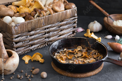 Vászonkép Top view of preparation and frying of edible wild mushrooms, food photo