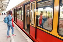 Pretty Young Tourist Woman Boarding A Train