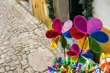 Pinwheels At The Entrance Of A Shop (Óbidos, Portugal)
