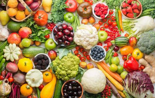 Healthy summer fruits vegetables berries background, cherries peaches strawberries cabbage broccoli cauliflower squash tomatoes carrots spring onions beans beetroot, pepper, top view, selective focus - 217925639