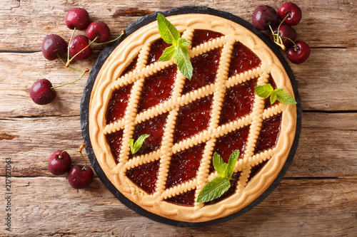 Homemade summer pastries cherry pie Crostata close-up on the table Canvas Print