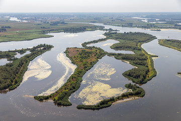 Aerial view estuary Dutch river IJssel with small islands and wetlands in lake Ketelmeer