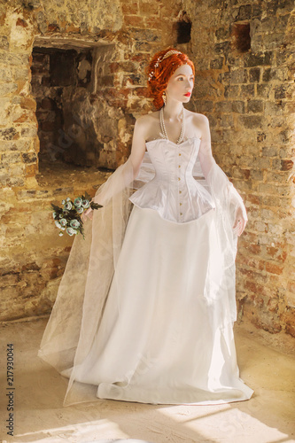 Photographie  Young renaissance redhead princess with hairstyle in old castle from fairytale