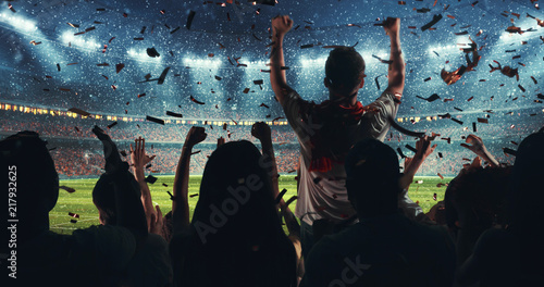 Photo  Fans celebrating the success of their favorite sports team on the stands of the