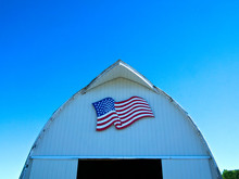 Front Of White Barn With American Flag On Minnesota Farm