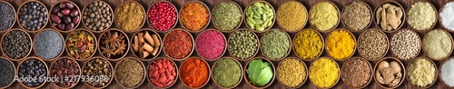 Spoed Fotobehang Aromatische Colorful Indian spices background, top view. large set of seasoning is lined with a rainbow