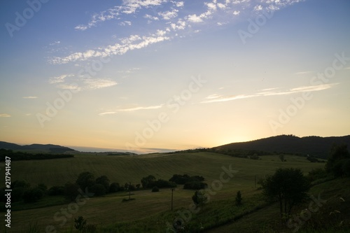 Foto op Aluminium Zwart Sunrise and sunset over the hills and town. Slovakia