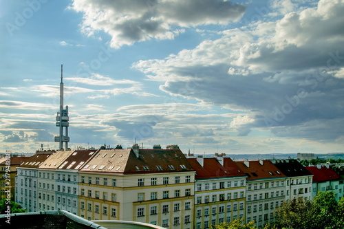 View of Prague cityline of a famous Zizkov tower on a summer evening with houses Poster