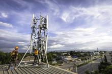Technician Installing Communication Tool On High Pole