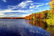Colorful Fall Foliage Surrounds A Lake In The Poconos Of Pennsylvania.