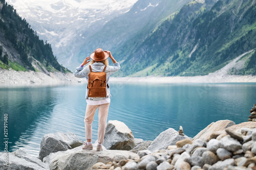 Traveler look at the mountain lake. Travel and active life concept. Adventure and travel in the mountains region in the Austria