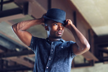 Young Man Holding Hat Attracti...