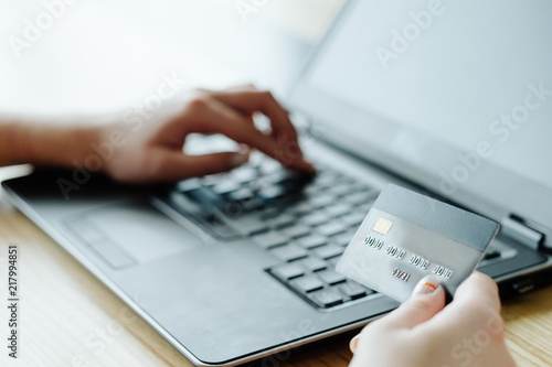 Fototapeta online money loan. financial operations on the internet. woman typing her bank card data on the laptop to get credit. obraz