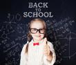 School kid thumb up. Little girl portrait, back to school