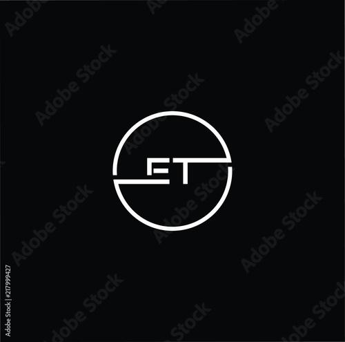 Photo  Initial letter ET TE minimalist art monogram circle shape logo, white color on b