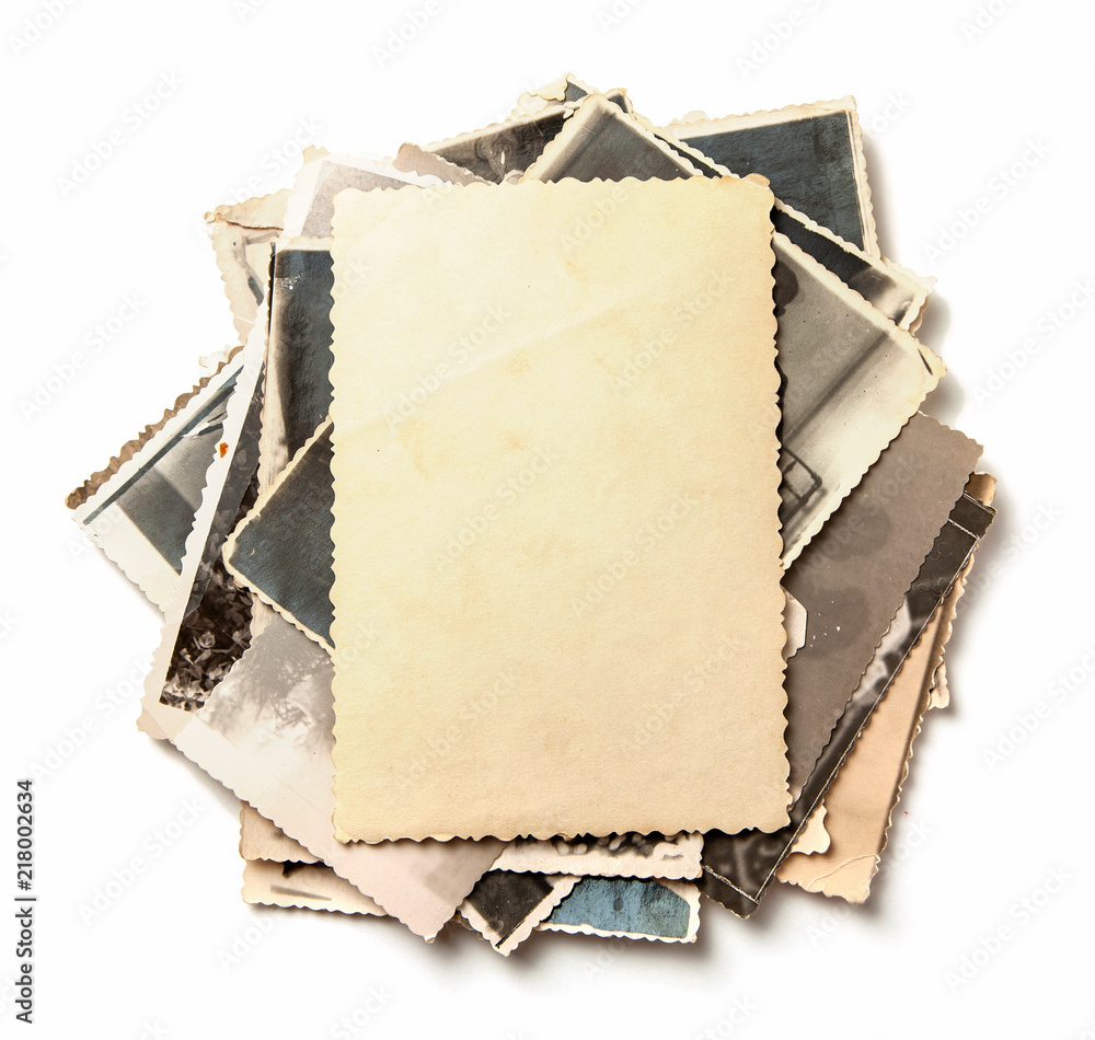 Fototapeta Stack old photos isolated on white background. Mock-up blank paper