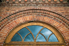 Close-up Of A Round Window  In Old House A Mansion Made Of Old Brick
