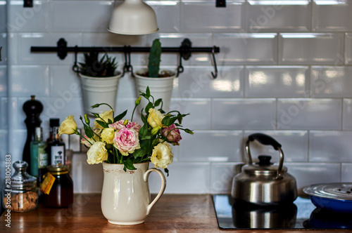 Rustic Kitchen Decor: Vintage Kitchenware And Porcelain White Vase With A  Beautiful Flowers. Vintage