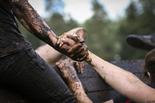 Mud Race Runners During Extrem...