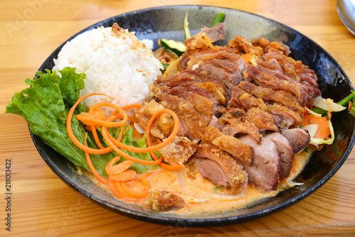 asian street food plate - roasted duck with rice and vegetables