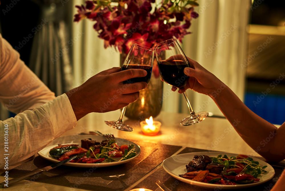 Fototapeta Happy couple on summer evening having romantic dinner.