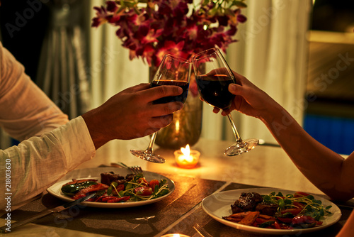 Fototapeta Happy couple on summer evening having romantic dinner. obraz