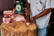 A Butcher Cutting The Fresh Me...
